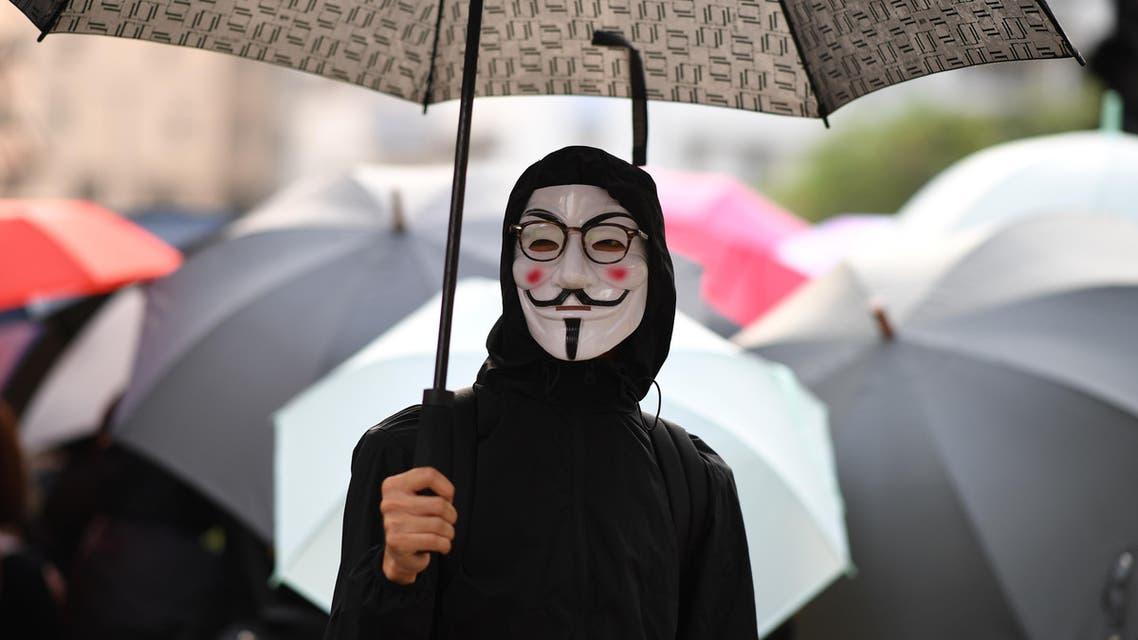 A demonstrator wearing a Guy Fawkes mask in Hong Kong, October 12 - AFP.jpg