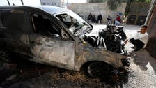 Palestinians: Israeli settlers torch cars in West Bank