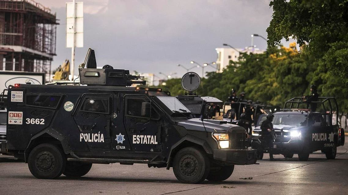 Mexican police patrol in a street of Culiacan, state of Sinaloa, Mexico. (AFP)