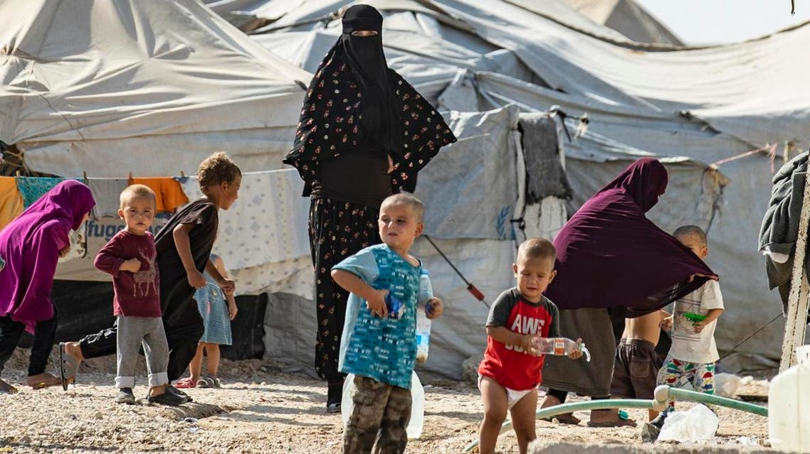 Women look after children at the Kurdish-run al-Hol camp for the displaced where families of ISIS foreign fighters are held, in the al-Hasakeh governorate in northeastern Syria, on October 17, 2019. (AFP)