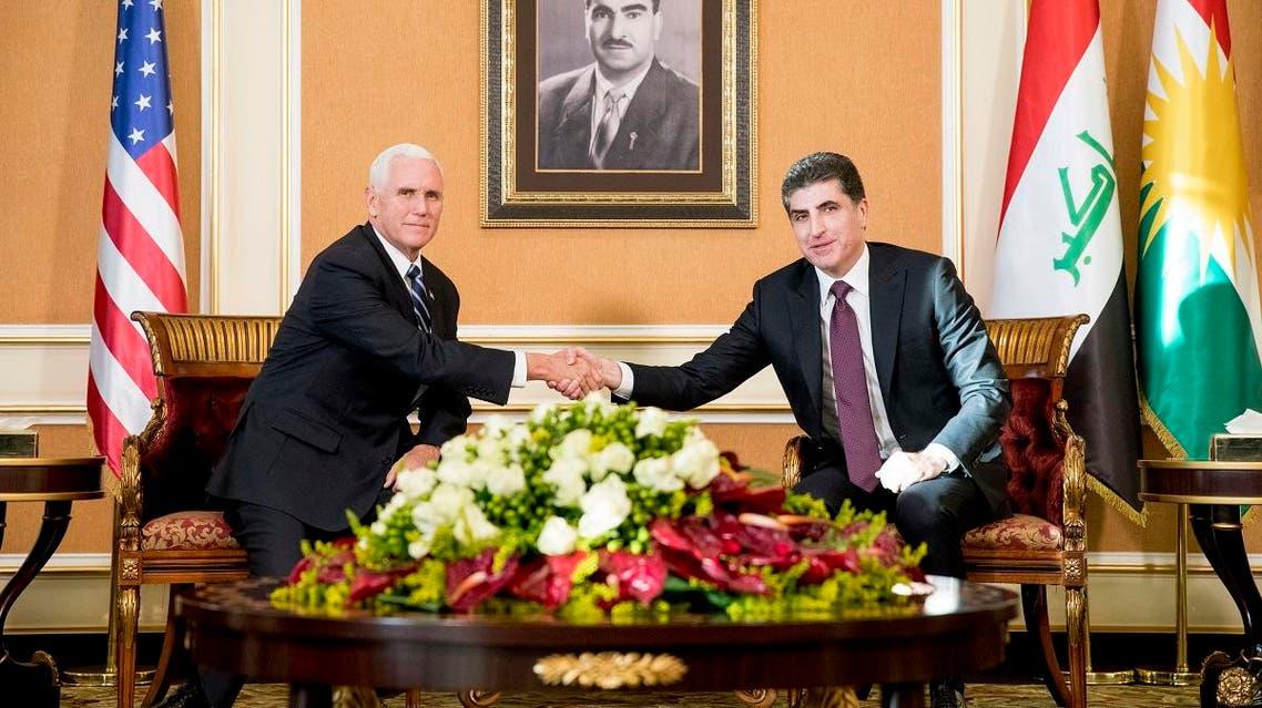 Vice President Mike Pence and Iraqi Kurdish Region President Nechirvan Barzani, right, shake hands during a bilateral meeting at Erbil International Airport in Erbil, Iraq, Saturday, Nov. 23, 2019. (AP)