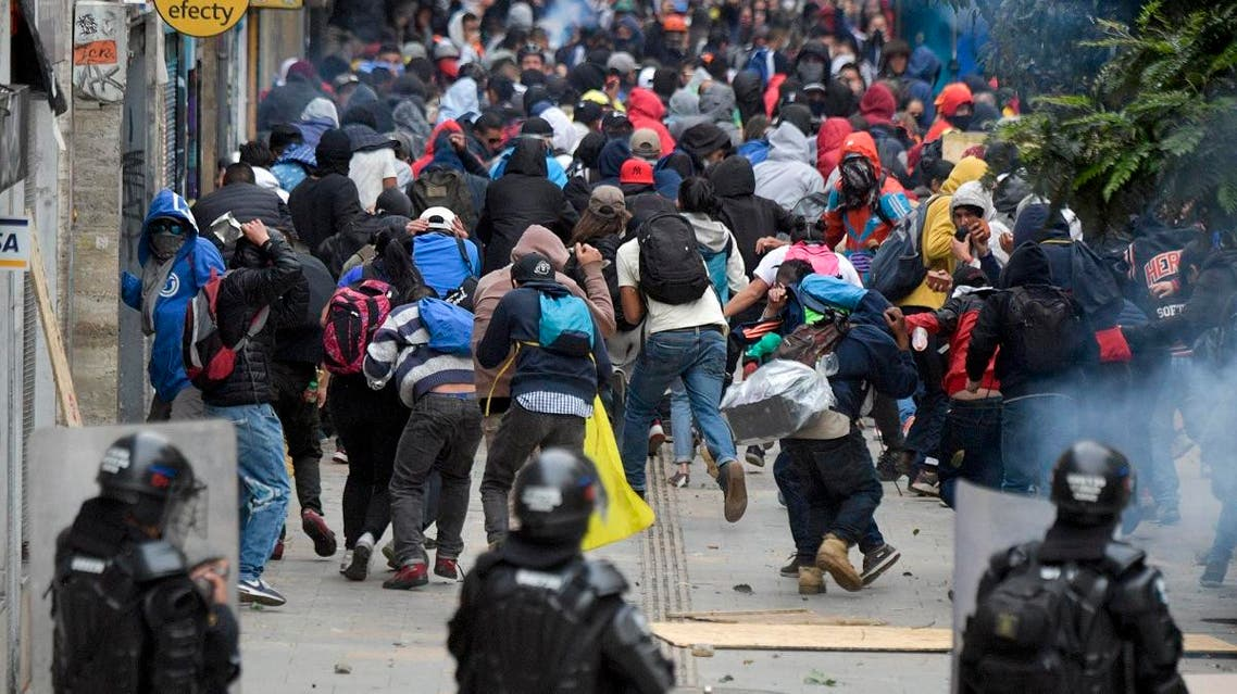 Demonstrators confront riot police during a protest a day after a nationwide strike by students, unions and indigenous against the government of Colombia's President Ivan Duque, in Bogota, on November 22, 2019. (AFP)