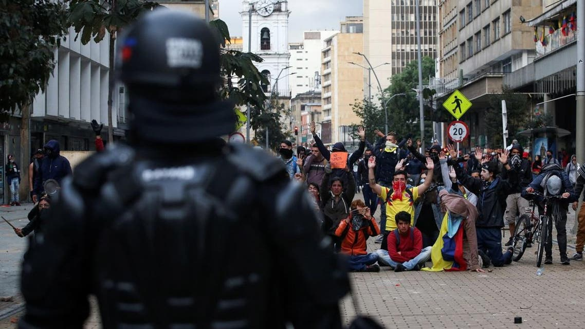 Demonstrators gesture in front of a member of riot police during a protest on the second day of a national strike, in Bogota, Colombia, on November 22, 2019. (Reuters)