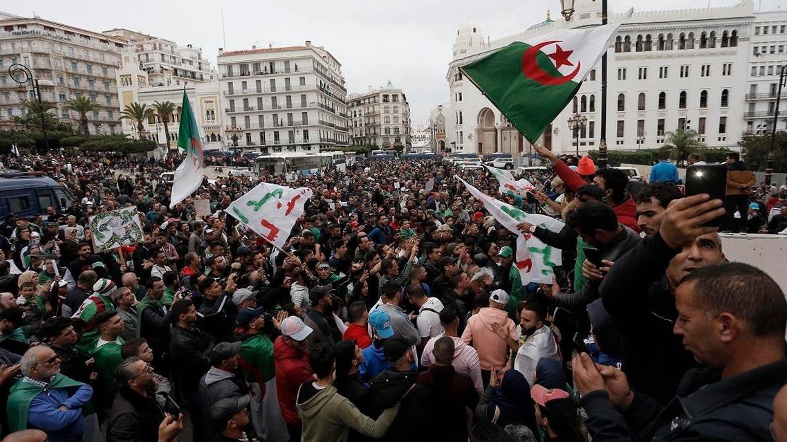 Algerian demonstrators take to the streets in the capital Algiers to protest against the government and reject the upcoming presidential elections, in Algeria, on November 22, 2019. (AP)