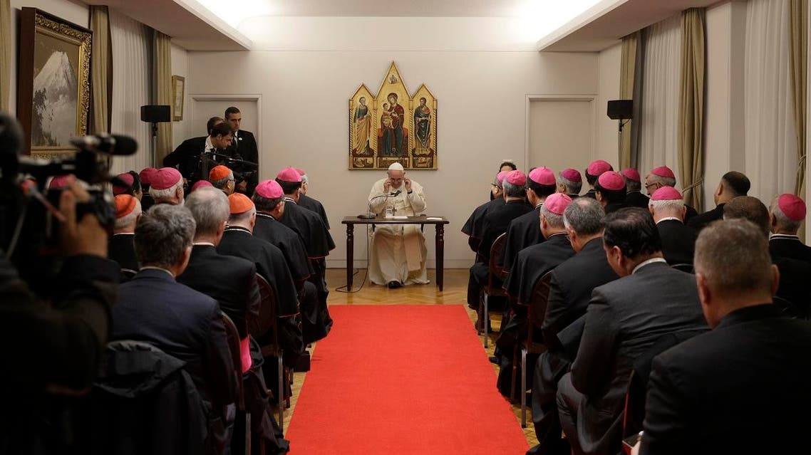 Pope Francis adjusts his glasses as he meets with Bishops at the Apostolic Nunciature in Tokyo, Saturday, Nov. 23, 2019. (AP)