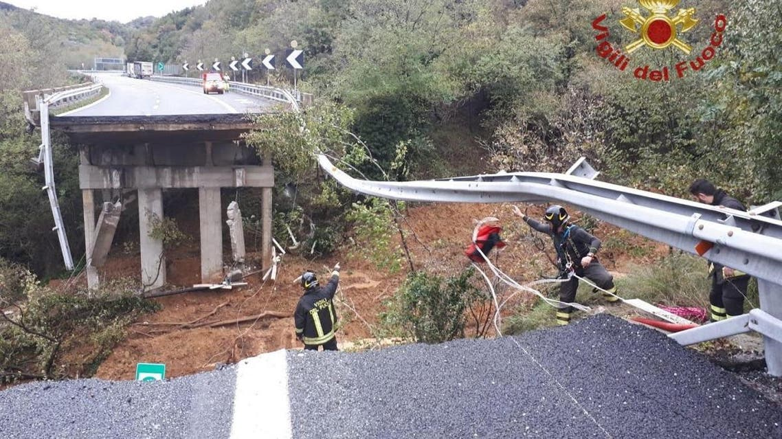 A portion of a motorway bridge linking Savona to Turin is seen after it collapsed due to a landslide near Savona, Italy, November 24, 2019. (Reuters)