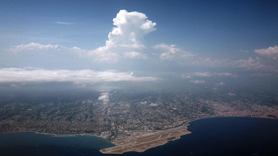 This picture taken on July 21, 2019 shows an aerial view of the French riviera city of Nice (R) and the Nice International Airport (Aeroport de Nice Cote d'Azur)(L) in Nice, southeastern France. (AFP)