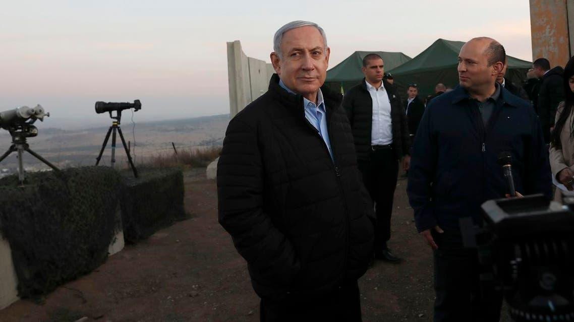 Netanyahu, center, and Defense Minister Naftali Bennett, visit an Israeli army base in the occupied Golan Heights on November 24, 2019. (AP)