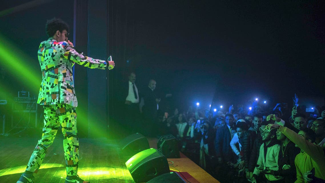 In this Friday, Nov. 22, 2019 photo, Moroccan rapper Abdelkrim Bouhjir, known as Kouz1, performs at a rap concert as part of the Visa for Music festival in Rabat, Morocco. (AP PhotoMosa'ab Elshamy)
