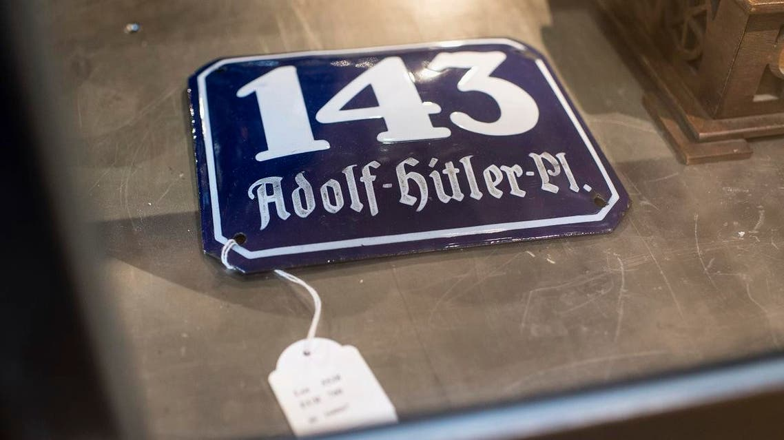 """In this Wednesday, Nov. 20, 2019, photo, a street sign for """"143 Adolf Hitler Place"""" is displayed for an auction at the """"Hermann Historica"""" auction house in Grasbrunn near Munich, Germany. (AP)"""