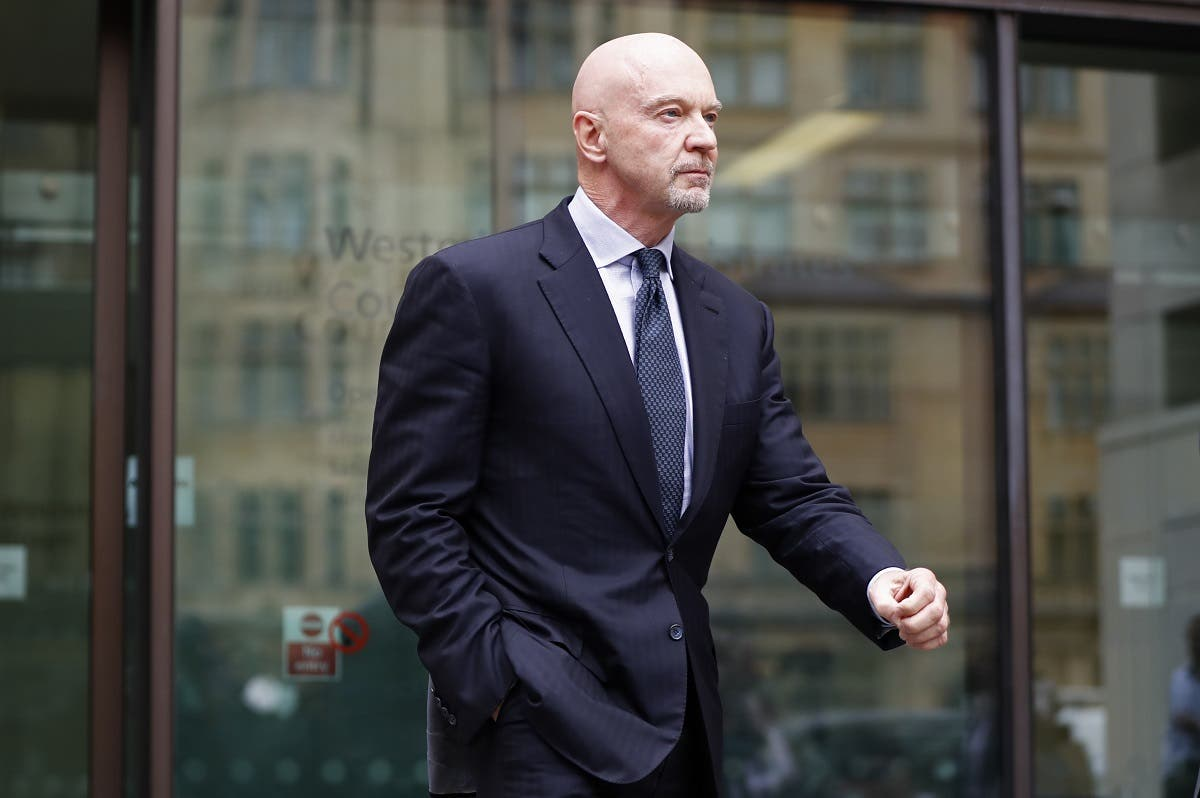 Former Barclays head of investment banking and investment management in the Middle East, Roger Jenkins, leaves after an appearance at Westminster Magistrates Court in central London on July 3, 2017. (AFP)