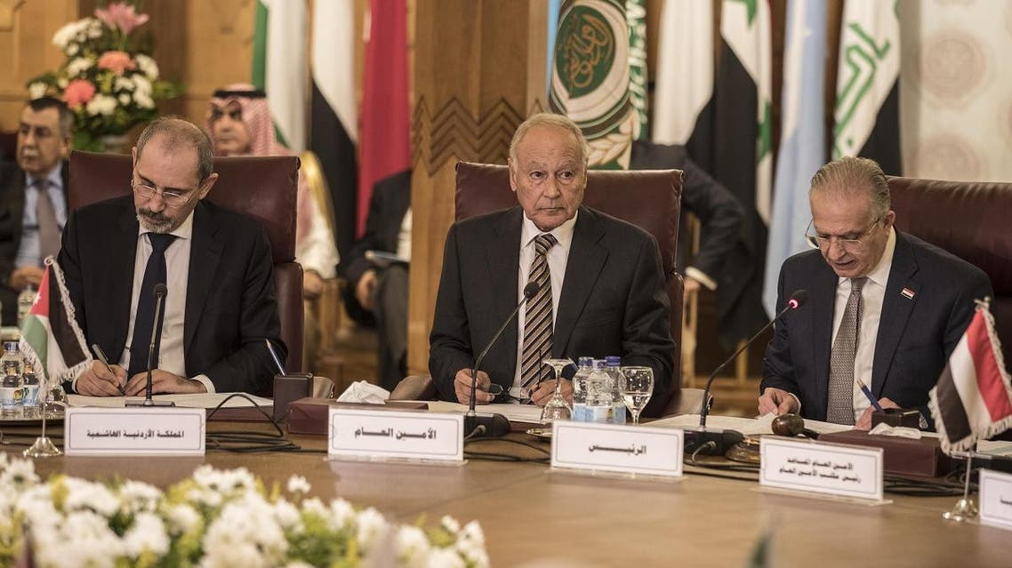 Arab League Secretary-General Ahmed Aboul Gheit (C), Iraqi Foreign Minister Mohamed al-Hakim (R), and Jordan's Foreign Minister Ayman Safadi attend an emergency meeting at the Arab League headquarters in the Egyptian capital Cairo, on November 25, 2019. (AFP)