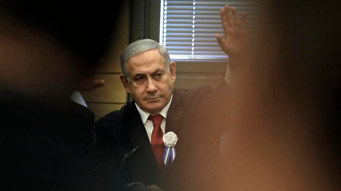 Israeli Prime Minister Benjamin Netanyahu raises his hand as he attends a meeting of Likud party members at the Knesset in Jerusalem on October 3, 2019. (AFP)