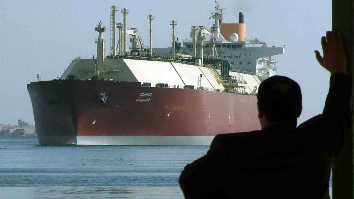 A man looks as the world's biggest Liquefied Natural Gas (LNG) tanker DUHAIL as she crosses through the Suez Canal April 1, 2008. The Qatari tanker, which was built to transfer LNG from Qatar to Europe and the U.S., is on her first trip ever from Qatar to Spain. REUTERS/Stringer (EGYPT)