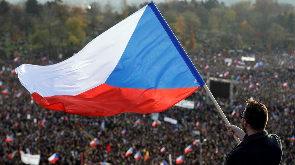 A man waves the Czech flag as demonstrators attend an anti-government rally  in Prague, November 16.jpg