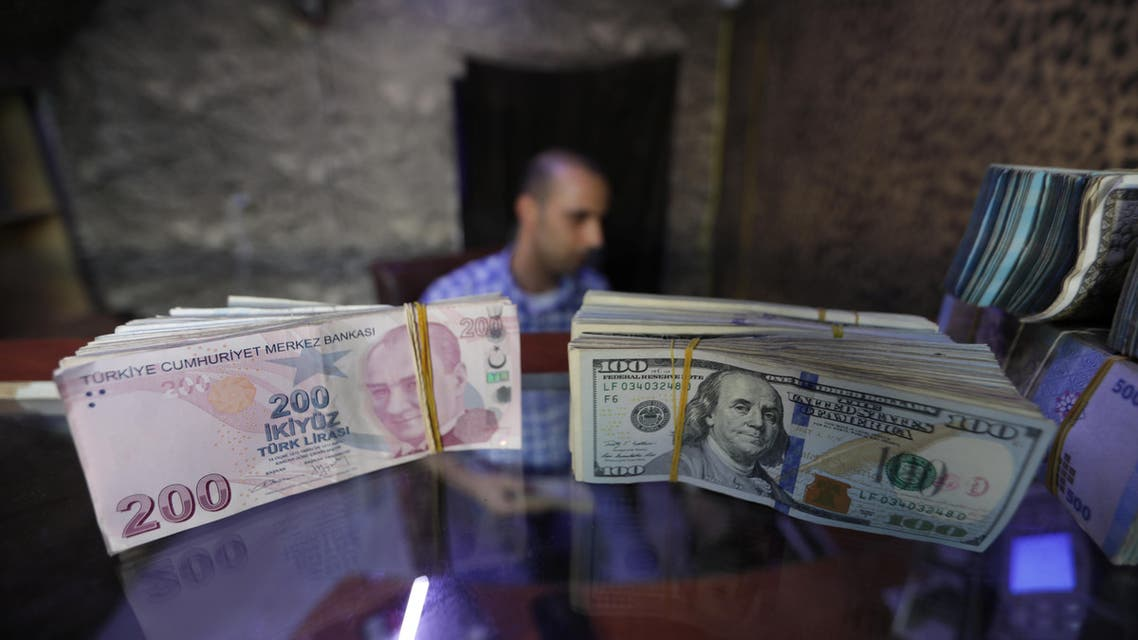 Reuters- Banknotes of U.S. dollars and Turkish lira are seen in a currency exchange shop in the city of Azaz