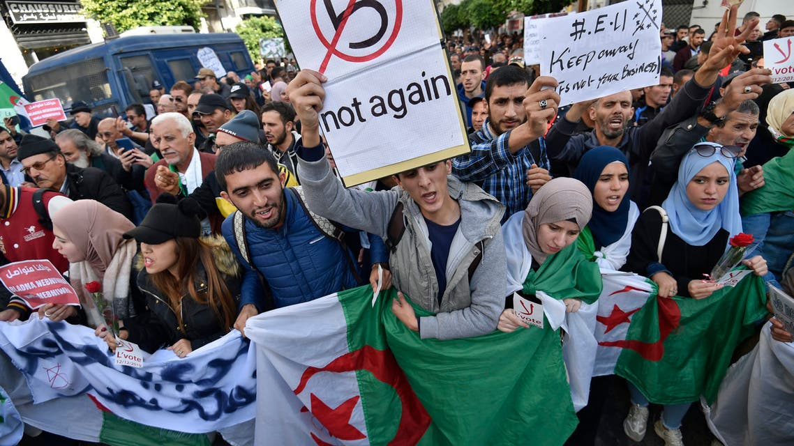 AFP Algeria demonstrators chant slogans against the upcoming presidential election as they carry national flags during an anti-government protest in the center of the capital Algiers on November 26 2019
