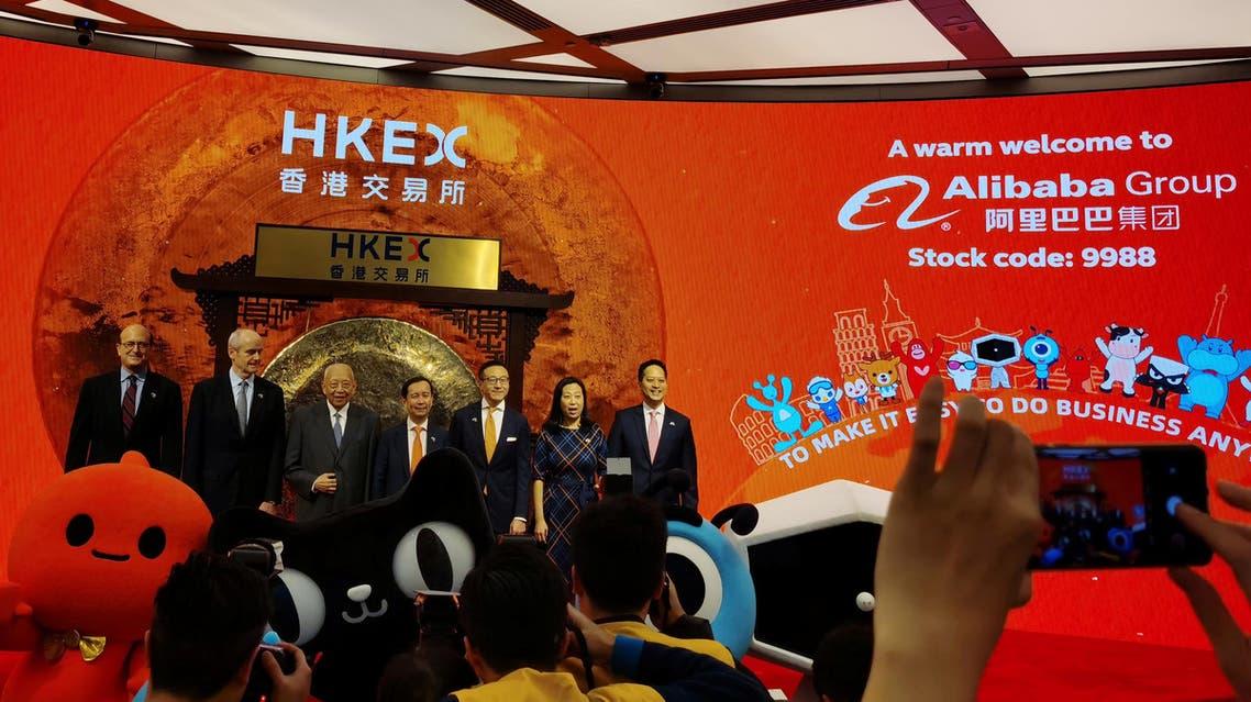 Reuters-Alibaba's Chairman and Chief Executive Officer Daniel Zhang, Vice Chairman Joseph Tsai and former Hong Kong chief executive Tung Chee-hwa attend Alibaba Group's listing ceremony at the Hong Kong Stock Exchange (HKEX) in Hong Kong, China