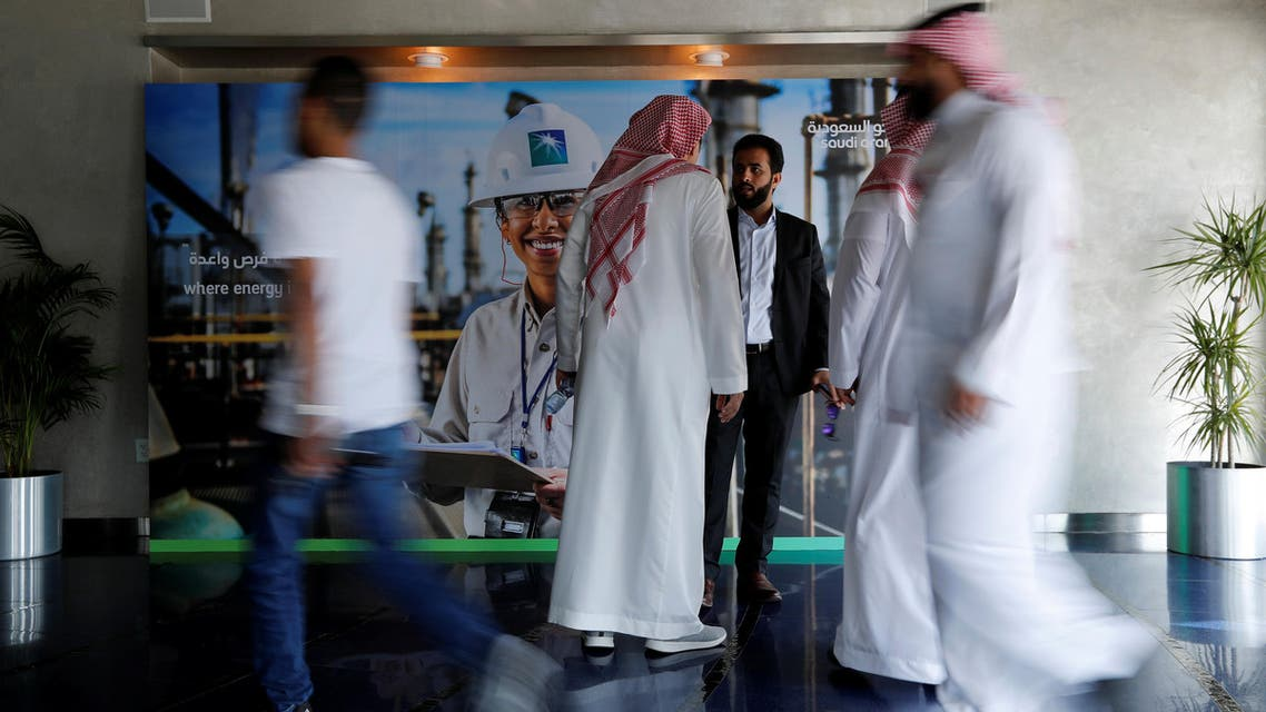 Reuters- People are seen before the start of a press conference by Aramco at the Plaza Conference Center in Dhahran