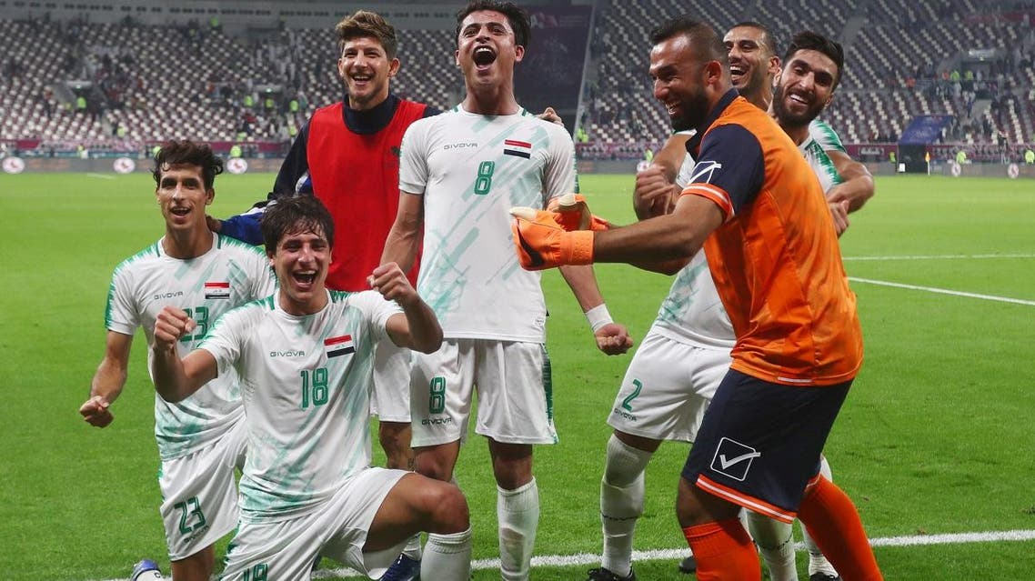 Iraqi players celebrate after their win against Qatar in the Gulf Cup Group A match at Khalifa International Stadium, Doha, Qatar, on November 26, 2019. (Reuters)
