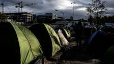 French police start moving migrants from northern Paris site
