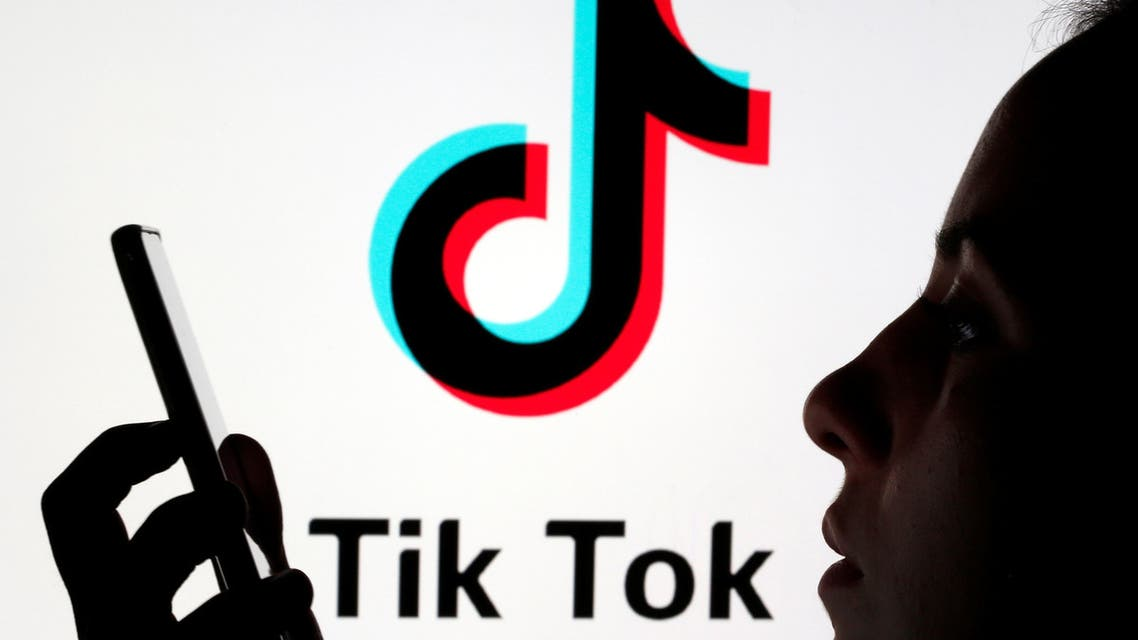 A person holds a smartphone with Tik Tok logo displayed in this picture illustration taken November 7, 2019. (Reuters)