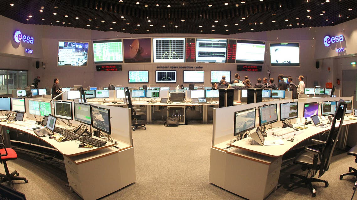 Engineers work at the main control room of the European Space Operations Centre (ESOC) of the European Space Agency (ESA) in Darmstadt, western Germany, during the controlled descent of the ESA space probe Rosetta onto the surface of Comet 67P/Churyumov-Gerasimenko, on September 30, 2016. Europe's Rosetta spacecraft was headed for a mission-ending crash on the comet it has stalked for two years, a dramatic conclusion to a 12-year odyssey to demystify our Solar System's origins.