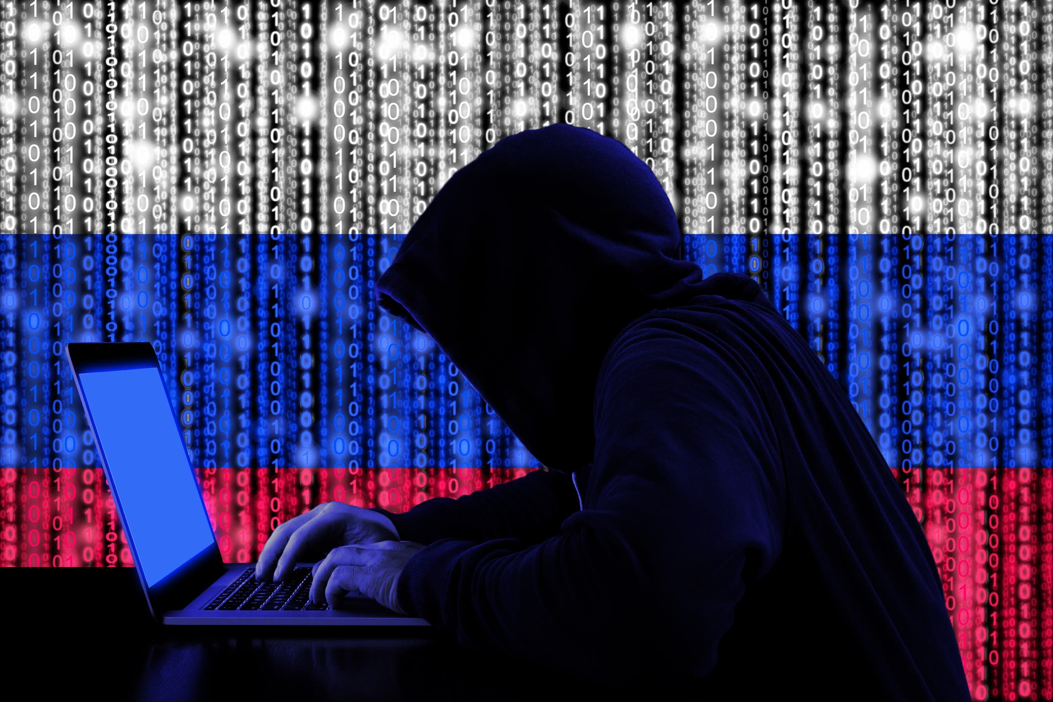 Hacker with Russian flag in the backdrop. (Supplied)