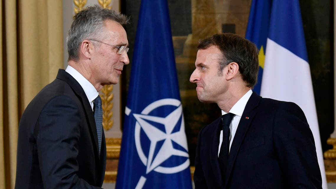 French President Emmanuel Macron (R) and NATO Secretary General Jens Stoltenberg shake hands after giving a press conference and holding a meeting at the Elysee palace in Paris on November 28, 2019. Bertrand GUAY / AFP