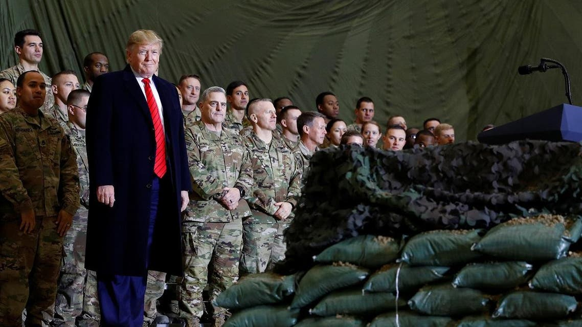US President Donald Trump delivers remarks to US troops in an unannounced visit to Bagram Air Base, Afghanistan. (Reuters)
