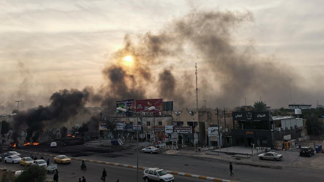nasiriyah smoke from protests in Iraq November 25 - AFP