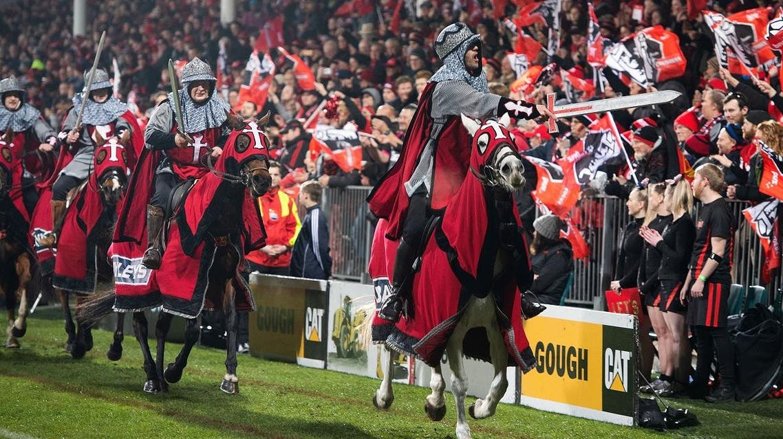 Crusaders Horsemen ride past supporters before the start of the Super Rugby final match between the Canterbury Crusaders of New Zealand and the Golden Lions of South Africa at AMI Stadium in Christchurch on August 4, 2018. (AFP)
