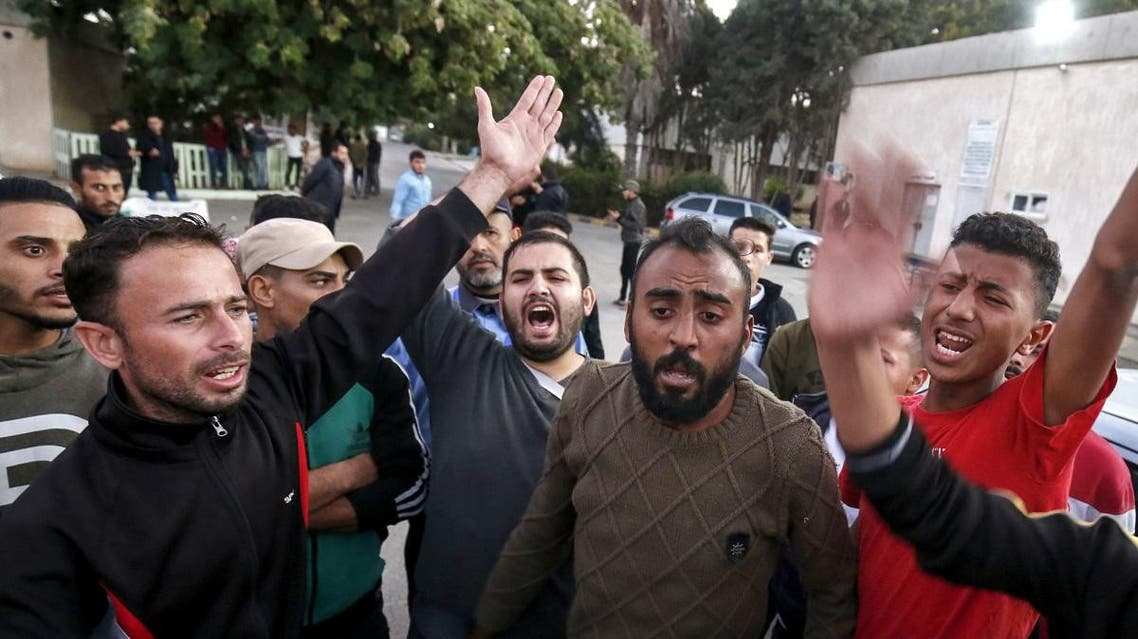 Relatives and friends of a Palestinian teenager who was killed near the border fence with Israel react as they mourn outside a hospital in Khan Yunis in the southern Gaza Strip on November 29, 2019. (AFP)
