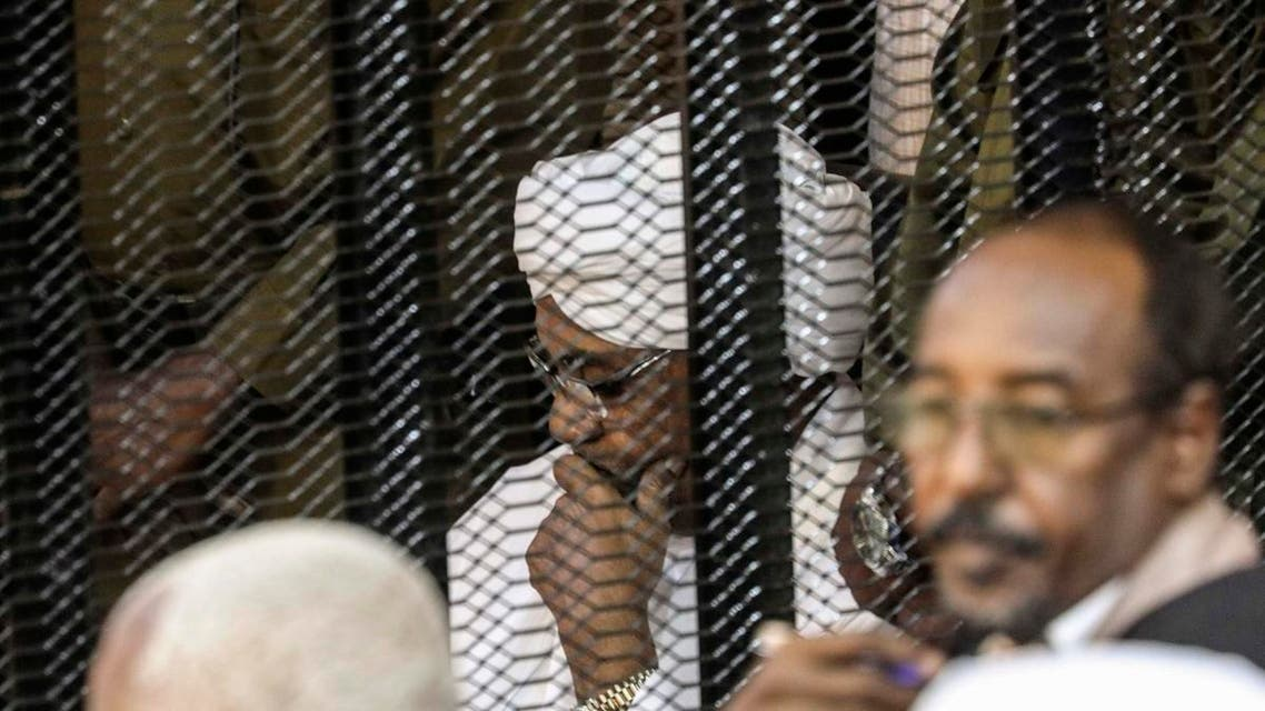 Sudan's former President Omar al-Bashir sits in a cage during his trial on corruption and money laundering charges. (File photo: AP)