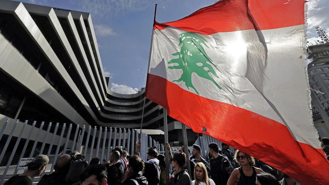 Lebanese anti-government protesters gather outside a building housing a department of the Ministry of Finance during a demonstration in Beirut on November 29, 2019. (AFP)