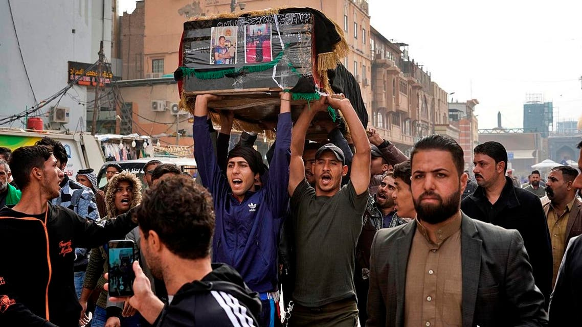 Mourners carry the coffin of Mehdi Kadim, 17, a protester killed during anti-government demonstrations, during his funeral in Najaf, Iraq, Friday, Nov. 29, 2019. (AP)
