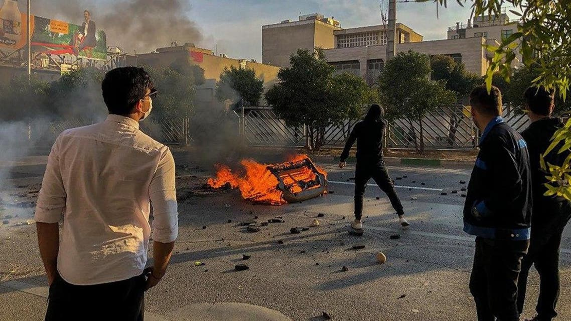 Iranian protesters block a road during a demonstration against an increase in gasoline prices in the central city of Shiraz on November 16, 2019. (AFP)