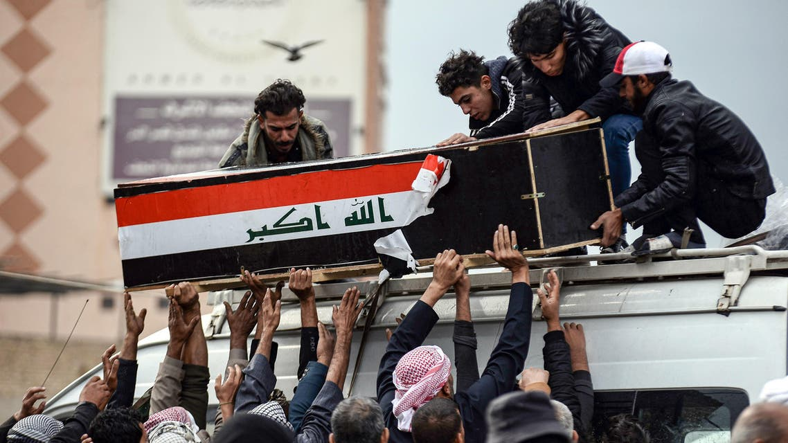 Iraqi mourners coffin flag protesters November 28, 2019, Najaf - AFP