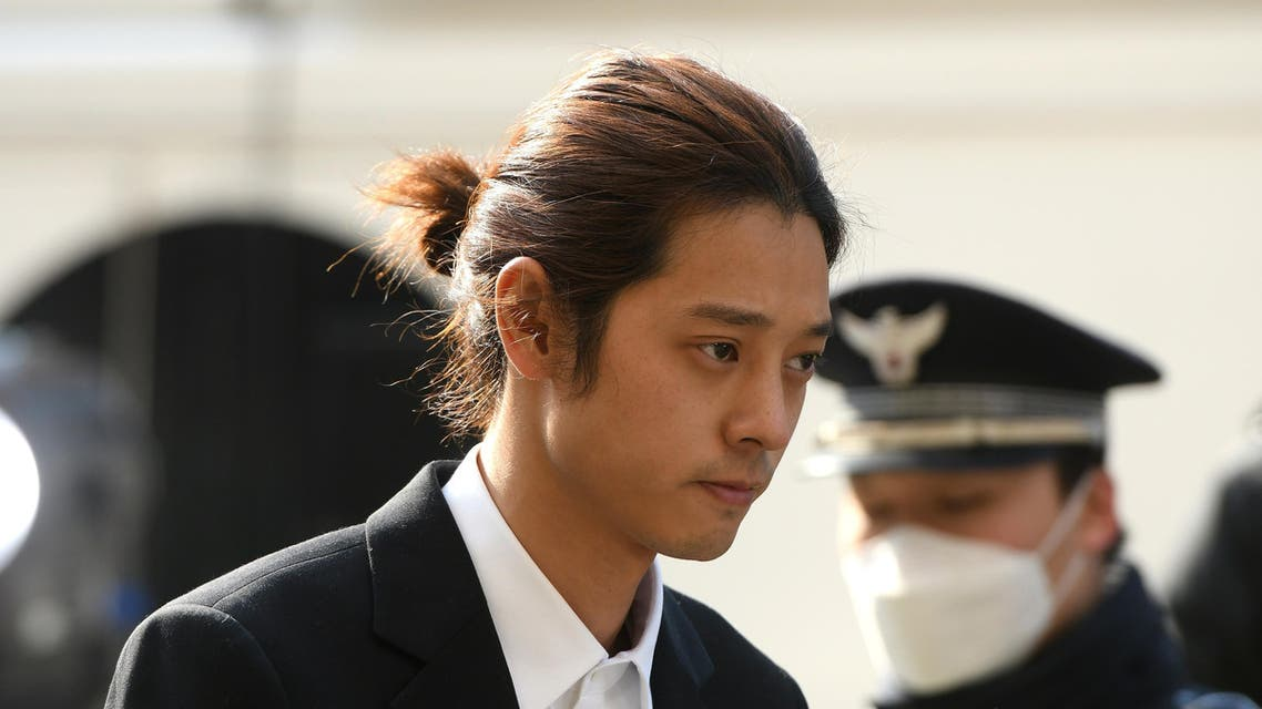 K-pop star Jung Joon-young (C) arrives for questioning at the Seoul Metropolitan Police Agency in Seoul on March 14, 2019. AFP