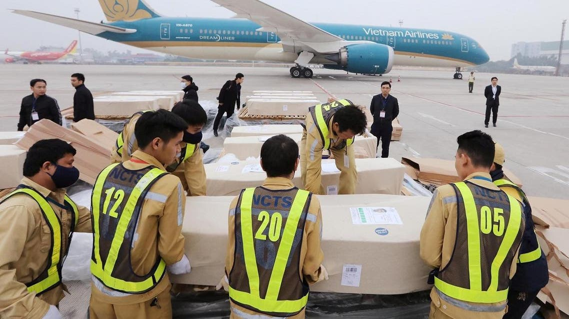 Airport workers transfer coffins belonging to some of the victims who were found dead in a truck container in the UK, from an airplane for homeland repatriation at Noi Bai airport in Hanoi, Vietnam November 30, 2019. (REUTERS)