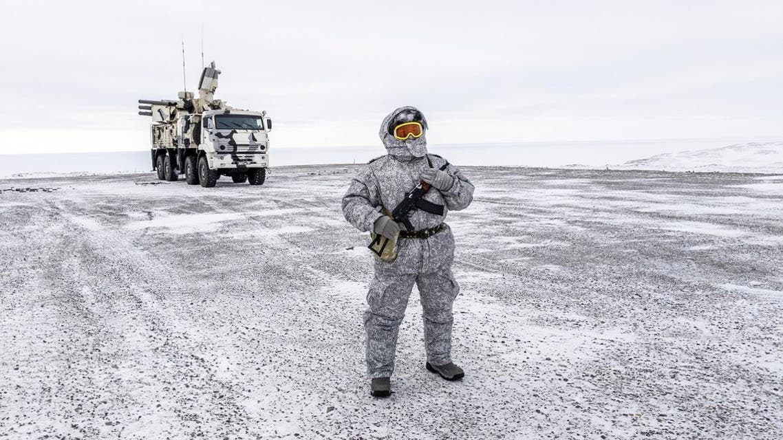A soldier holds a machine gun as he patrols the Russian northern military base on Kotelny island, beyond the Artic circle on April 3, 2019. (AFP)