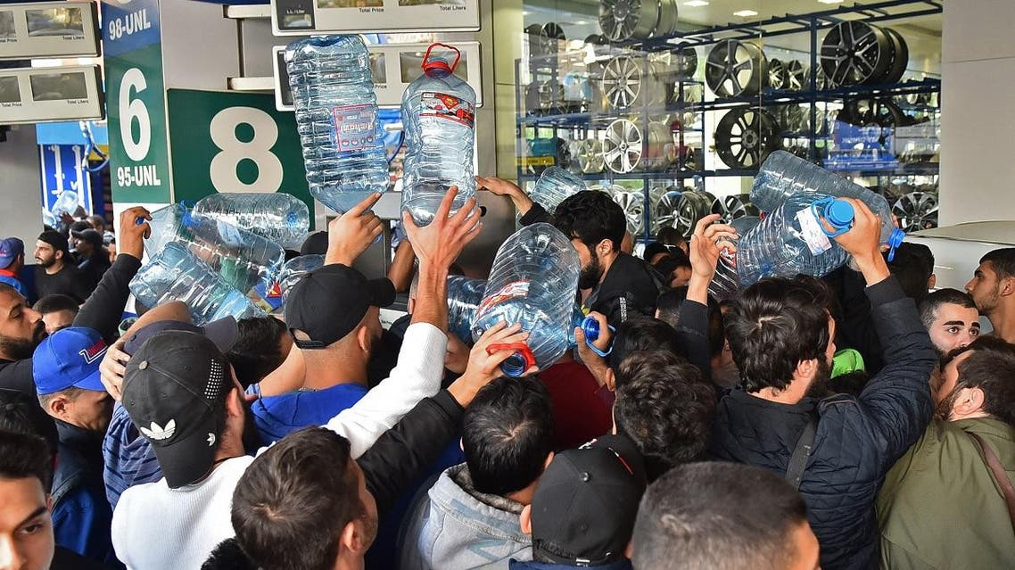 Lebanese people queue in front of a petrol station in Beirut's Cola district on November 29, 2019, following an open strike called for by the Syndicate of Fuel Station Owners. (AFP)