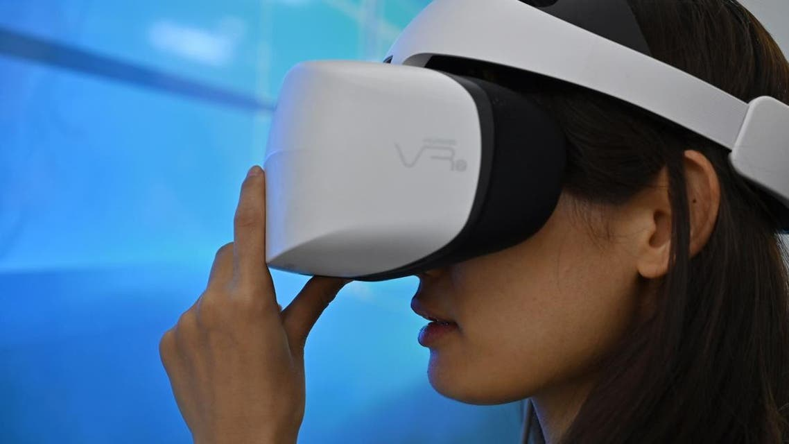 A woman checks a Huawei 3D Virtual Reality headset during the Consumer Electronics Show, Ces Asia 2019 in Shanghai on June 11, 2019. (AFP)