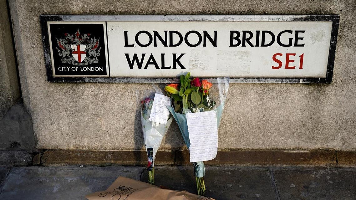 Floral tributes are pictured close to London Bridge in the City of London, on November 30, 2019, following the November 29 terror incident in which two people died after being stabbed on the bridge. (AFP)