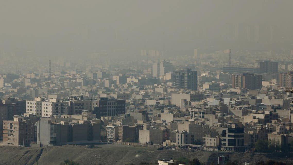 A general view taken from Western Tehran shows a blanket of brown-white smog covering the city as heavy pollution hit the Iranian capital on November 13, 2019. (AFP)
