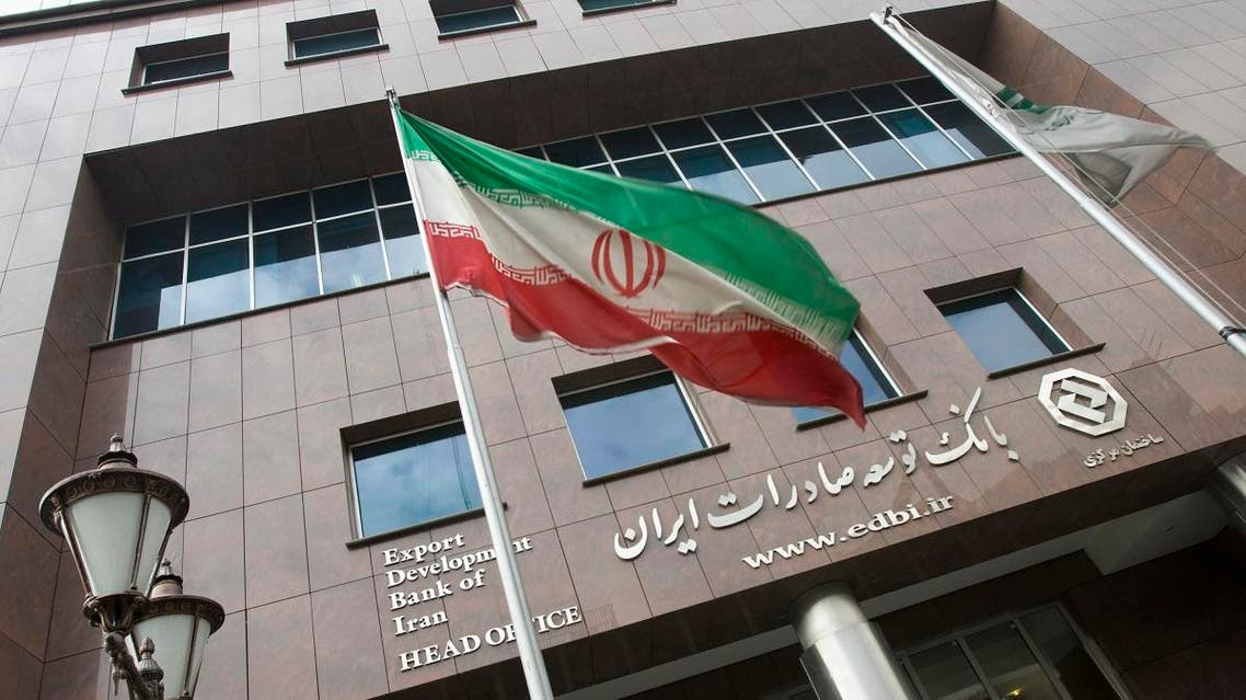 An Iranian flag flutters in front of the head office of the Export Development Bank of Iran (EDBI) in Tehran November 9, 2008. (Reuters)