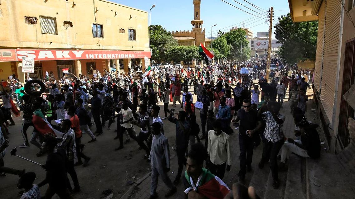 Sudanese protesters march during a demonstration in the centre of Sudan's capital Khartoum towards the prime minister's offices. (AFP)