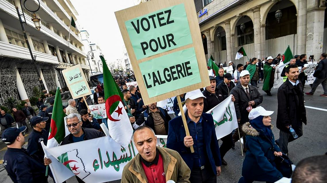 People march during a demonstration in the centre of the Algerian capital Algiers on November 30, 2019, in support of the upcoming presidential vote scheduled to take place in less than two weeks. (AFP)