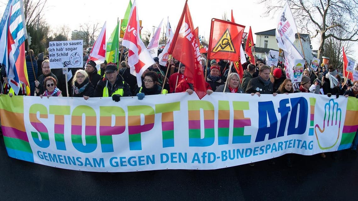 """People march through the city center of Braunschweig, in north-central Germany, with a banner reading """"Stop the AfD"""", on November 30, 2019. (AFP)"""