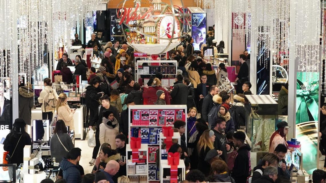 Consumers begin their Black Friday specials shopping as Macy's opens their doors at 5pm on Thanksgiving Day on November 28, 2019 in New York. (AFP)
